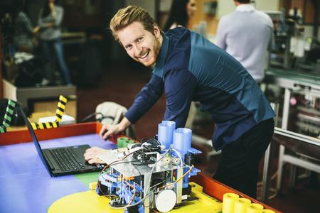 Photo pour Young people in the robotics classroom - image libre de droit