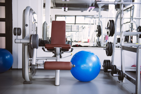 Foto de Interior of new modern gym with equipment - Imagen libre de derechos