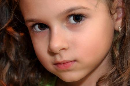 Foto de Potrait of curly hair little girl - Imagen libre de derechos