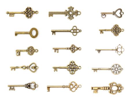 Photo pour View at vintage metal keys set isolated on the white background - image libre de droit
