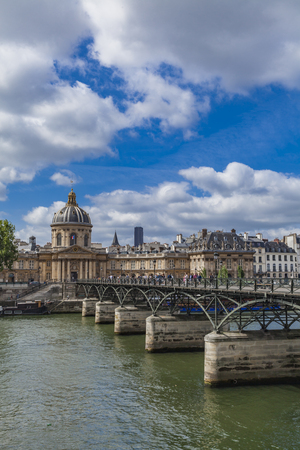 Photo for PARIS, FRANCE - JUNE 16, 2017: Unidentified people on the Pont des Arts in Paris, France. Bridge was opened in 1984 on the place of the first metal bridge in Paris. - Royalty Free Image