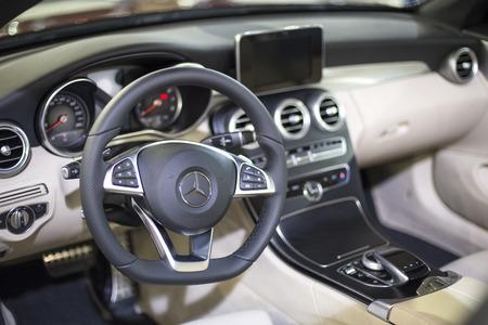 Foto de BELGRADE, SERBIA - MARCH 28, 2017: Interior of the Mercedes car in Belgrade, Serbia. Mercedes-Benz is a global automobile manufacturer founded at 1926. - Imagen libre de derechos