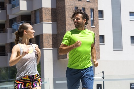 Photo pour Young couple jogging for fitness in urban environment on a beautiful summer day - image libre de droit