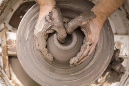 Photo pour Close up detail view at an artist makes clay pottery on a spin wheel - image libre de droit