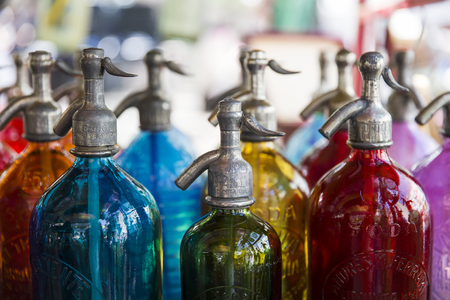 Foto de BUENOS AIRES, ARGENTINA - JANUARY 21, 2018: Soda bottles at San Telmo flea market in Buenos Aires, Argentina. With more than 154 liters per person in 2014, Argentina is the world leader in soft drink purchases. - Imagen libre de derechos