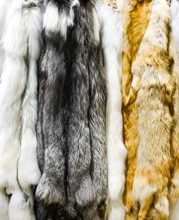 Photo pour Closeup of the dark marble artic and red fox furs - image libre de droit