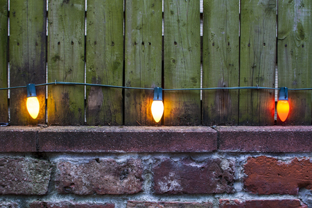 Photo for View at three vintage lightbulbs on the old wall - Royalty Free Image