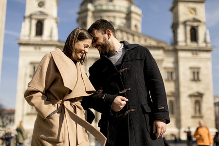 Photo for Loving couple with the St. Stephens Basilica behind them in Budapest, Hungary. - Royalty Free Image