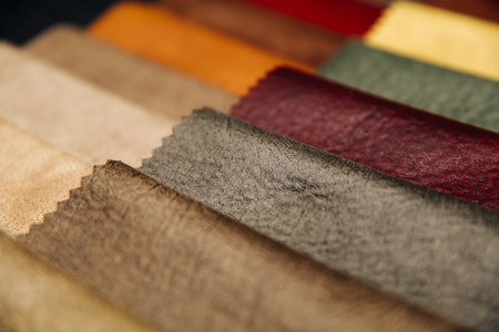 Photo for Closeup of the colorful furniture covers in the upholstery workshop - Royalty Free Image