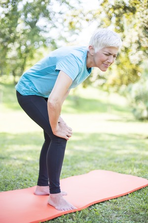 Foto für Senior sporty woman has  knee pain while workout - Lizenzfreies Bild
