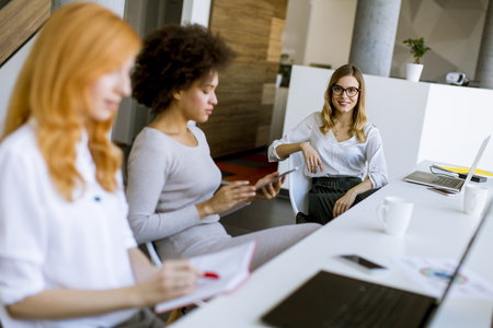 Photo for Young businesswomen working in modern office - Royalty Free Image