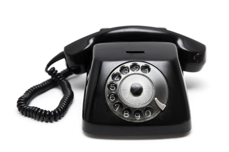 Photo pour Black vintage telephone  isolated on the white background - image libre de droit