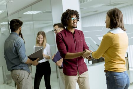 Photo for A group of creative young people standing in the modern startup office - Royalty Free Image