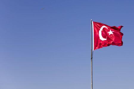 Foto de View at Turkish flag waving in the wind at blue sky - Imagen libre de derechos