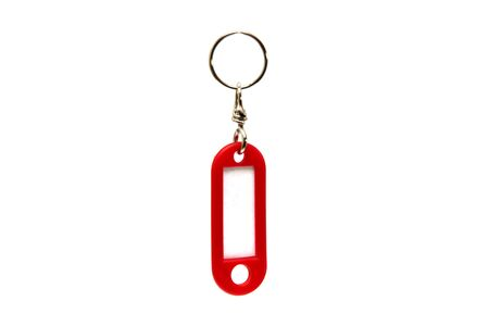 Foto de Red key chain with name tag isolated on the white background - Imagen libre de derechos