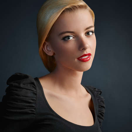 Photo for Beautiful blonde girl with red lips and modern haircut - Royalty Free Image