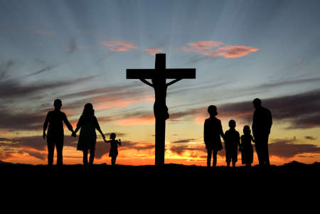Photo for Families walking toward the Cross over sunset background - Royalty Free Image