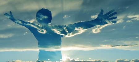 Photo pour Double exposure image of man silhouette with wide open arms - image libre de droit