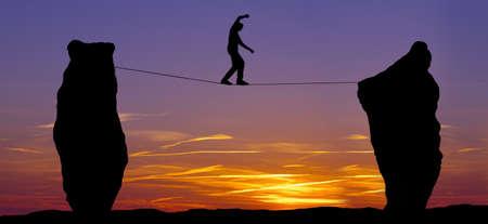 Photo pour High line walker between two rocks concept of risk taking and challenge - image libre de droit