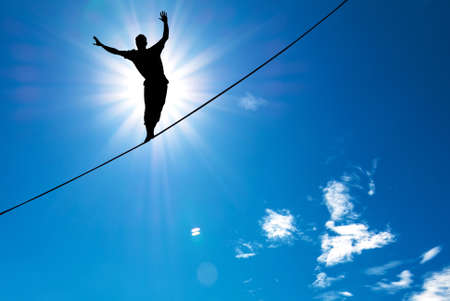 Photo pour Man balancing on the rope concept of risk taking and challenge - image libre de droit
