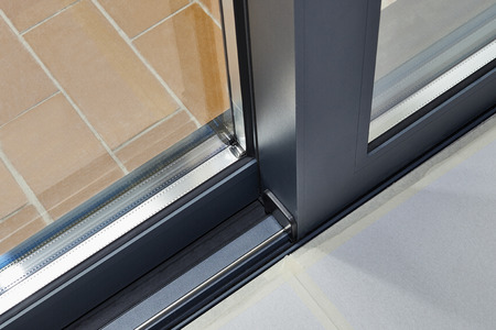 Photo for Sliding glass door detail and rail embed in floor - Royalty Free Image