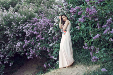 Photo for Girl in a long dress walking in the botanical garden - Royalty Free Image