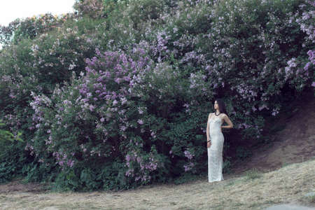 Photo for A walk with a girl in the flowered garden - Royalty Free Image