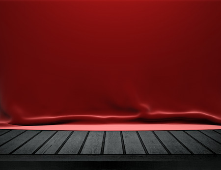 Wood table with red velvet cloth background