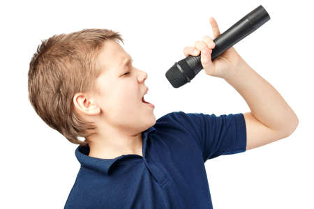 Photo for Boy singing into a microphone. Very emotional. - Royalty Free Image