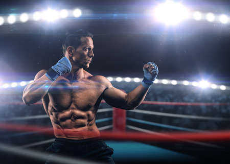 Photo pour A strong man in the ring in blue boxing bandages preparing for battle - image libre de droit