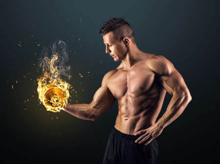 Photo pour Handsome power athletic man bodybuilder doing exercises with dumbbell. Fitness muscular body on dark background. - image libre de droit