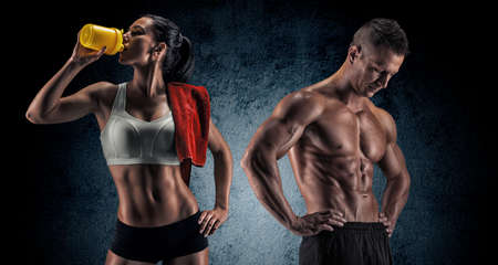 Photo for Bodybuilding. Strong man and a woman posing on a dark background - Royalty Free Image