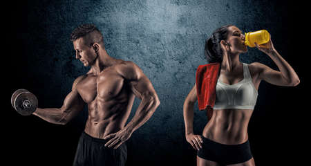 Photo pour Bodybuilding. Strong man and a woman posing on a dark background - image libre de droit