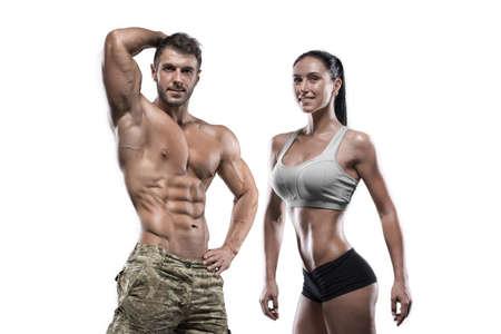Foto de Sports guy and sexy girl posing in the studio - Imagen libre de derechos