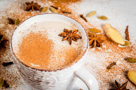 Photo pour Traditional indian masala chai tea with spices - cinnamon, cardamom, anise, white background. Copy space - image libre de droit