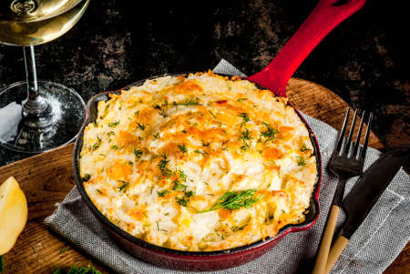 Photo for Skillet Shepherd's Pie, british casserole in cast iron pan, with minced meat, mashed potatoes and vegetables, on dark rusty background, copy space - Royalty Free Image