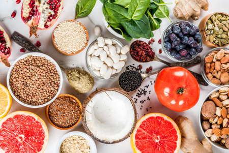 Photo pour Set of organic healthy diet food, superfoods - beans, legumes, nuts, seeds, greens, fruit and vegetables.. white background copy space. - image libre de droit