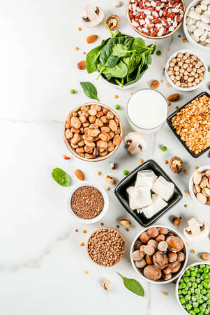 Photo for Healthy diet vegan food, veggie protein sources: Tofu, vegan milk, beans, lentils, nuts, soy milk, spinach and seeds. Top view on white table. - Royalty Free Image