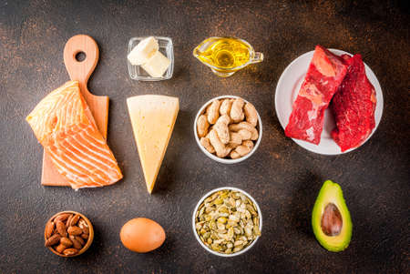 Photo for Ketogenic low carbs diet concept. Healthy balanced food with high content of healthy fats. Diet for the heart and blood vessels. Organic ingredients, dark rusty background, copy space top view  - Royalty Free Image