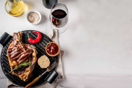 Photo for Fresh grilled meat beef steak with with red wine, herbs and spices. Top view copy space white marble background - Royalty Free Image