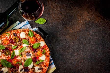 Photo for Pizza and red wine on dark background top view copy space - Royalty Free Image