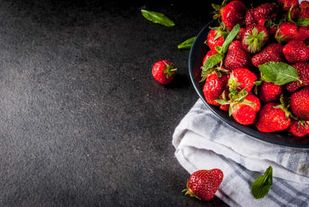 Photo for Fresh raw organic strawberry, dark stone background copy space top view - Royalty Free Image