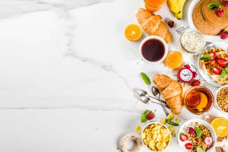 Photo pour Healthy breakfast eating concept, various morning food - pancakes, waffles, croissant oatmeal sandwich and granola with yogurt, fruit, berries, coffee, tea, orange juice, white background - image libre de droit