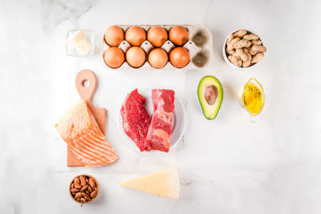 Photo pour Ketogenic low carbs diet concept. Healthy balanced food with high content of healthy fats. Diet for the heart and blood vessels. Organic food ingredients, white marble background, copy space top view - image libre de droit