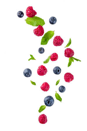 Photo for Creative layout, background, with fresh berries, simple pattern on white background. Raspberry, blueberry, mint leaves, slices of lemon.  - Royalty Free Image
