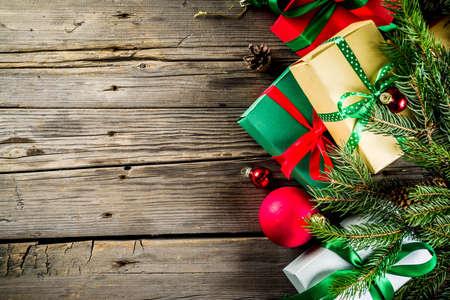 Foto de Christmas festive background with decorations and colorful gift boxes on wooden board - Imagen libre de derechos