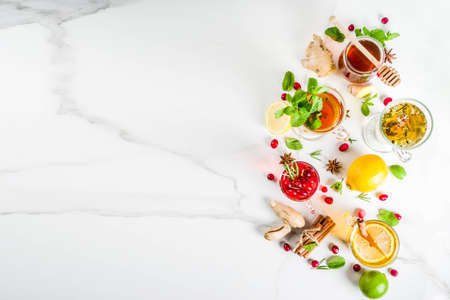 Photo for Various autumn winter herbal fruit and berry tea, with cranberry, mint, rosemary, lemon. lime. flowers, medical herbs and spices. top view copy space - Royalty Free Image