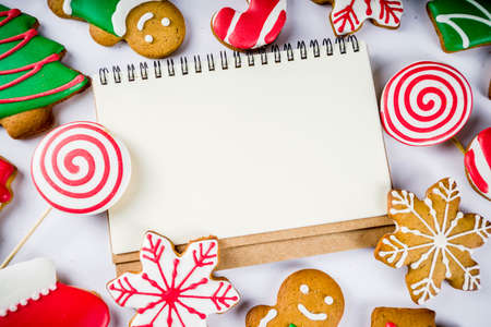 Photo for Various traditional colorful sugar glazed christmas gingerbread cookies, on white background top view copy space - Royalty Free Image