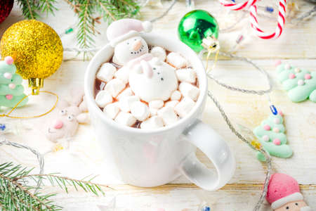 Foto per Creative idea for christmas drink, delicious hot chocolate with funny marshmallow snowman, christmas tree, rain dear, santa, on home background with xmas decoration copy space top view - Immagine Royalty Free