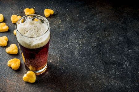 Photo for Beer and heart snack, treatment idea for Valentine's day, dark rusty background copy space - Royalty Free Image